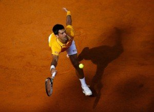 Djokovic of Serbia returns the ball to Almagro of Spain during their match at the Rome Open tennis tournament in Rome